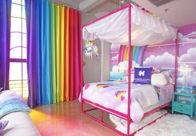 Hotels.com is letting nostalgic Millennials spend the night in the rainbow-hued Lisa Frank room of their childhood dreams—complete with Trapper Keepers.
